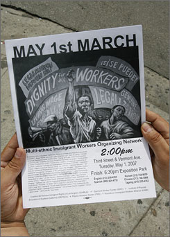 Jorge-Mario Cabera, working for the Central American Resource Center, handed out flyers Monday inviting immigrant workers to the May Day march in Los Angeles. One million participated in the marches last year, but fewer are expected this year due to increased enforcement.