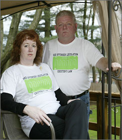 "Mark and Sharon Jackson wear a ""Kristen's Law"" shirt in honor of their daughter, who was killed by a convicted sex offender. Kristen's Law would require such offenders to display special license plates on their cars."