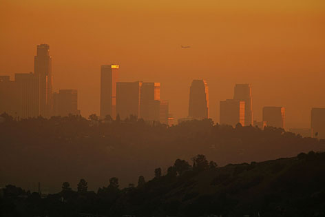 Smog envelopes downtown Los Angeles in November 2006. Although the city was once again named most polluted, it decreased its number of bad ozone days.