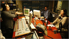 "Technical Director Paul Kodila, left, chats with Dave and Susan Konig as they host the radio show ""Speak Now"" on SIRIUS Satallite Radio in Manhattan."