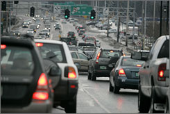 Cars chug through traffic in Burlington, Vt., in March. New rules require a significant drop in emissions by 2016.