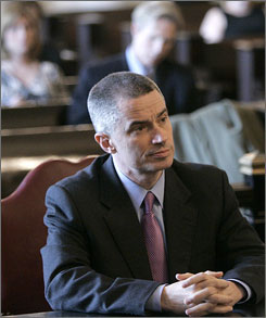 Former N.J. Gov. James McGreevey sits in Superior Court in Elizabeth, N.J., during a divorce hearing with his estranged wife, Dina Matos McGreevey.