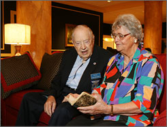 Clayton David, a World War II pilot, reminisces with Joke Folmer, who as a young Dutch woman helped rescue him when his plane went down in 1944.