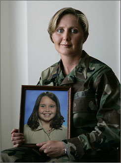 Lt. Eva Crouch, seen here holding a picture of her daughter, fought for a Kentucky law saying a parent's absence due to military activation cannot be used to justify permanent changes in custody or visitation.