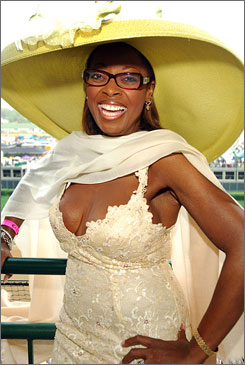 The Attitudes by Angie hat worn in this picture by Star Jones was made especially for her after she sent a photo of her spaghetti-strapped Badgley Mischka dress to Louisville hat designer Angie Schultz.