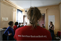 "Doyle Canning, 26, of Burlington, Vt., wears a T-shirt promoting ""Turn Your Back on Bush."" Students and young activists in the state have been vocal against the president's policies and the Iraq War."