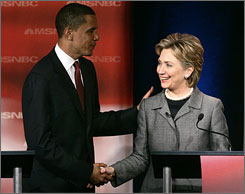 Democratic presidential candidate Barack Obama, left, shakes hands with Hillary Clinton at the conclusion of the South Carolina Democratic party's presidential candidates debate in Orangeburg, S.C.