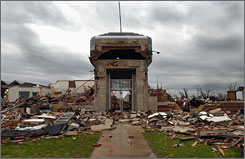 A killer tornado demolished all but the stone entrance of the high school in Greensburg, Kan. Residents began to return Monday to find about 95% of the town gone.