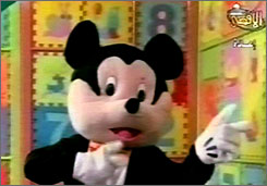 "An image taken from Al-Aqsa TV, a station run by Hamas, shows a giant black-and-white Mickey Mouse lookalike rodent named ""Farfour,"" who spreads the message of armed resistance."