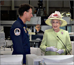 Queen Elizabeth listens as NASA astronaut Mike Foale introduces her to the crew aboard the International Space Station, during her visit to NASA's Goddard Flight Center in Greenbelt, Md.