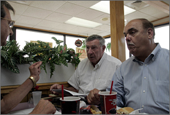 Paul Grimm, center, meets with Robert Rabon and Ralph Panzrino, left, in Conway, S.C. Grimm, 65, moved to Conway from Ohio in 1993. Within a few months, he was tapped as an officer of the Horry County GOP.