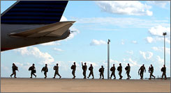 Soldiers line up to board a plane to deploy from Fort Hood, Texas, to Iraq. Deployments coincide with increased child abuse, according to a study. Fort Hood works with the Military Child Education Coalition to improve community involvement with its 70,000 military families.