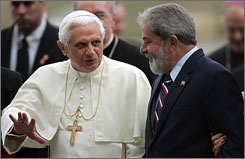 Pope Benedict XVI chats with Brazilian President Luiz Inacio Lula da Silva upon his arrival at the Sao Paulo airport, Wednesday. Benedict is making a key visit to the Latin American region, the first in his two-year papacy.