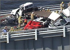 In this photo made from video provided by WJZ-TV, authorities work an accident on the westbound Bay near Annapolis, Md., on Thursday. Three people were killed in the crash involving a tractor-trailer and several other vehicles, police said.