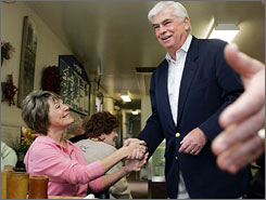 Sen. Chris Dodd greets Jane Wilson in Burlington, Iowa on Saturday. Most of the money Dodd has raised for his presidential campaign this year has come from industries he regulates.