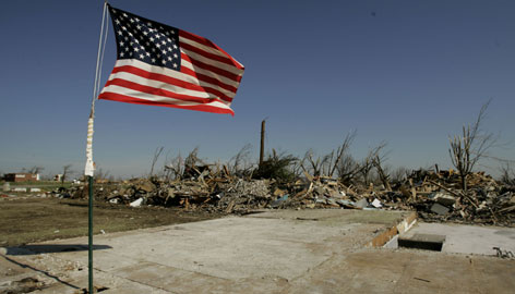 A flag flies over the cleaned-up remains of a home in Greensburg, Kan., Sunday. Most of the town was destroyed after a massive tornado hit the community last Friday.