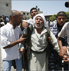 Palestinian relatives react after the killing of eight members of Mahmoud Abbas's Presidential Guard on Tuesday.