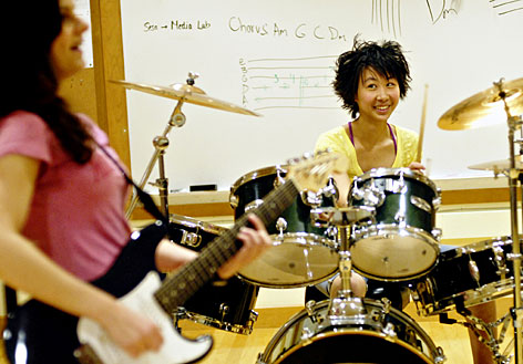 When she's not studying biosensors at Case Western Reserve University, Joanne Wang plays drums with a friend from Hathway Brown High School in Shaker Heights, Ohio. Wang is one of 20 members of the annual All-USA High School Academic First Team.