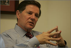 Former House Majority Leader Tom DeLay is seen in his Washington office in this December 2006 file photo. Delay has spent more than $1 million in campaign funds on legal fees over the last 30 months.