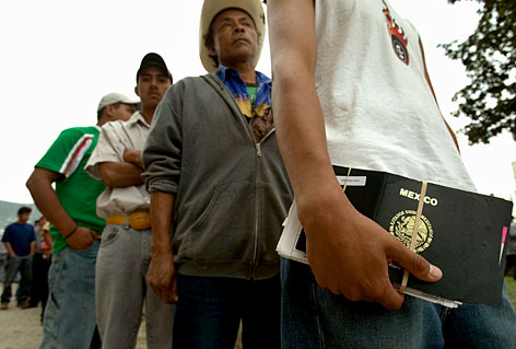 Mexicans line up outside the U.S. consulate in Monterrey, Mexico, for a working visa interview on Thursday. Key Democratic and Republican senators, together with the White House, announced an immigration overhaul that would fortify the border and grant quick legal status to millions of illegal immigrants already in the U.S.