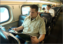 Jerad Schutt reads the Nashville Scene as he waits for the Music City Star, a commuter train.