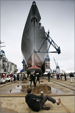 Jeff Sterett of Denver, Colo., gets down low to photograph his brother, Ryan Sterett, and his fiancee, April Fetzer, after the christening of the destroyer Sterett at Bath Iron Works. The warship is named for the men's great-great-great-great-great uncle, Lt. Andrew Sterett.