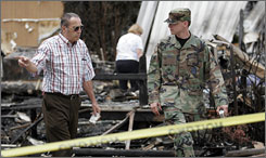 Bill Gallagher, left, lost his home to a forest fire. The New Jersey Air National Guard said a flare dropped from one its F-16s may have started the blaze. The military began handing out claims forms to people like him who lost personal property in the blaze.
