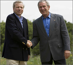 President Bush and NATO Secretary General Jaap de Hoop Scheffer shake hands following a joint a press conference at Bush?s Prairie Chapel ranch in Crawford, Texas, on Monday.
