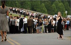 Elizabeth Mabry joins thousands of mourners waiting in line to attend funeral services for the Rev. Jerry Falwell at Thomas Road Baptist Church on Tuesday in Lynchburg, Va.