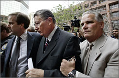 "Randy ""Duke"" Cunningham, center, arrives at a federal courthouse in San Diego in March 2006 for sentencing for bribery and tax evasion. The case prompted the House to adopt new rules."