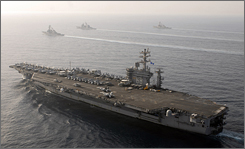The USS Nimitz steams with other ships through the Gulf of Oman, near Iran,  Thursday.