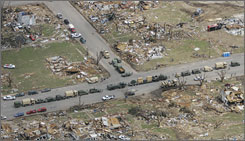 Kansas National Guard stages along a street in Greensburg, Kan., in early May after a massive tornado destroyed the town.