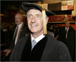 Former White House Chief of Staff Andrew Card arrives in the procession during commencement ceremonies at the University of Massachusetts in Amherst, Friday, May 25, 2007. Card received an honorary doctor of public service degree.