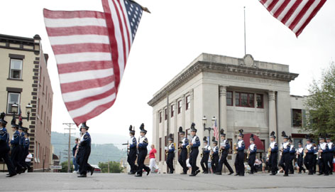 A high school marching band makes its way up Allegheny Street during a Memorial Day parade Monday in Hollidaysburg, Pa. In conversations this past week, Hollidaysburg residents reflected on the USA's past sacrifices and its role overseas.