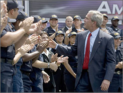 President Bush shakes hands with trainees at the Federal Law Enforcement Training Center in Glynco, Ga., today after speaking about immigration reform.