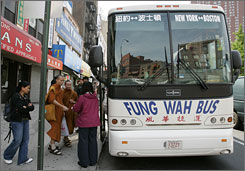 Curbside carrier Fung Wah loads passengers in New York City's Chinatown onto a bus headed for Boston's Chinatown. The carrier keeps its fares low by avoiding the overhead other bus lines have.