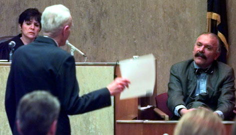 Dr. Jack Kevorkian, left, representing himself, questions Dr. L. J. Dragovic, Oakland County Medical examiner, during Kevorkian's  murder trial in Pontiac, Mich., on March 23, 1999.