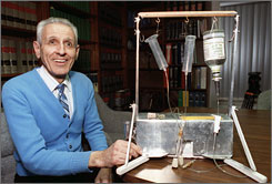 "Kevorkian poses with his ""suicide machine"" in Michigan, in this Feb. 6, 1991 file photo. The man known as ""Dr. Death"" will leave prison June 1 after serving more than eight years of a 10- to 25-year sentence in the death of a Michigan man."