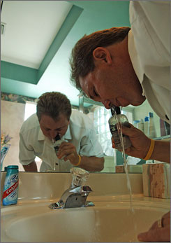 Todd Templin uses a saline rinse to clean his sinuses as a means to minimize his allergies.