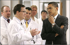 Democratic Sen. Barack Obama talks with Dr. Mark Anderson while touring a cardiology research lab at the University of Iowa.