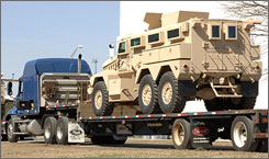 The new MRAP troop vehicles, shown here upon delivery to the U.S. government, are facing a stiff challenge from the latest type of bombs used by insurgents in Iraq.