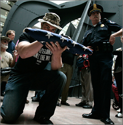 Iraq war veteran Adam Kokesh holds a U.S. flag during an anti-war demonstration April 26 at the Hart Senate Office Building on Capitol Hill in Washington, D.C.