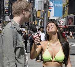 Holly Eglinton interviewed pedestrians in New York's Times Square as part of a recent competition for a job as a newscaster on the Naked News website. Eglinton went on to win the contest ahead of two other finalists.