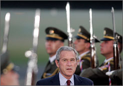 "Bush walks past the guard of honor as he arrives at the Ruzyne airport in Prague, Czech Republic, for a two-day working visit. ""I feel very strongly that the United States must take the lead in promoting democracy around the world,"" Bush told a group of European journalists last week."