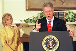 First lady Hillary Rodham Clinton stands next to President Clinton in this file photo as he delivers his strongest public denial of allegations that he had an affair with former intern Monica Lewinski, during a White House press conference in 1998.