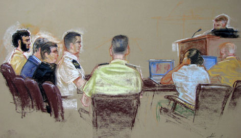 In this courtroom sketch reviewed and cleared for release by U.S. Military officials, Guantanamo detainee Omar Khadr, far left, sits flanked by two civilian and one military lawyer, inside the courtroom during a U.S. Military Tribunal arraignment, at Guantanamo U.S. Naval Base, Cuba on Monday.