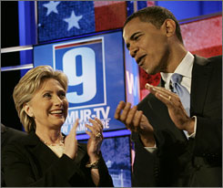 Sens. Hillary Rodham Clinton and Barack Obama applaud on stage just before the start of the Democratic Presidential Candidates Debate at Saint Anselm College in Manchester, N.H., Sunday. Among Democrats alone, Clinton leads Obama by only a few points, according to a USA TODAY Poll taken recently.