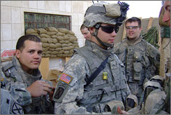 U.S. Army Spc. Alex Jimenez, 25, left, and Pvt. Byron Fouty, 19, center, in their barracks at Patrol Base Inchon in Quarghuli, Iraq. They have been missing since a May 12 ambush in the village.