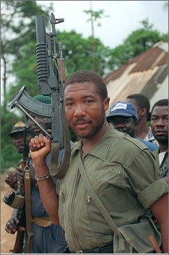 Then-rebel leader Charles Taylor held his AK-47 rifle as he led a march on Monrovia to oust President Samuel Doe. The atrocities in Sierra Leone's 1991-2002 civil war are well-documented. Fighters -- often kidnapped children -- murdered thousands of men, women and children and mutilated more. Women were raped and abducted to become sex slaves.