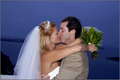 Andrew Speaker kisses his wife Sarah Cooksey after they're married in Santorini, Greece, May 18.